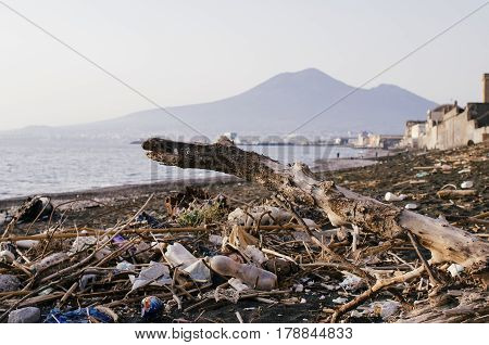garbage and wastes on the beach in Naples