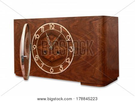 Old table clock in wooden case isolated on white background
