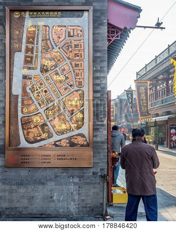 Tianjin, China - Nov 1, 2016: Artistic map or directory on the wall at the Tianjin Ancient Cultural Street. Morning scene to what is a very popular tourist area.