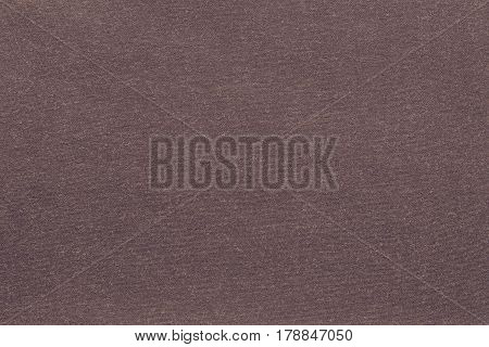 background and texture of knitted or woolen fabric of monotonous dark brown color