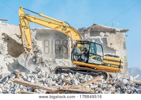 Tivat, Montenegro- December 7, 2016:Demolition of an old house with excavator