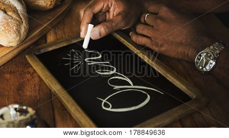 People Hand Writing Open on Chalk Board