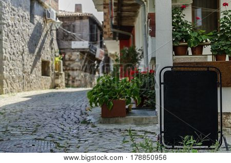 view of quiet street in old mediterranian village with place for your text