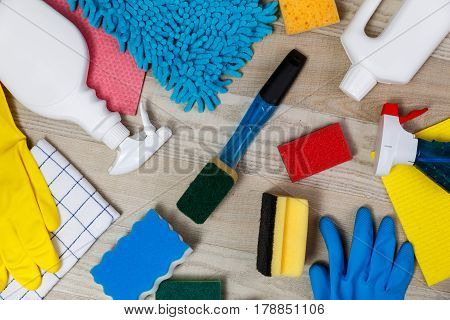 House cleaning products. Sponges and chemicals bottles. Rubber gloves, towel and washcloth. Household equipment.