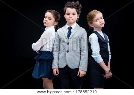 Children Posing In Business Formalwear On Black