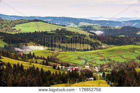 rural mountain landscape in a misty spring morning