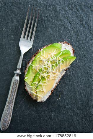 Rye Bread Bruschetta. Avocado Parmesan And Cream Cheese Sandwich Served On A Stone Board On Blue Bac