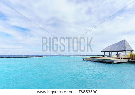 Small boat dock for boarding tourists on Maldives Island