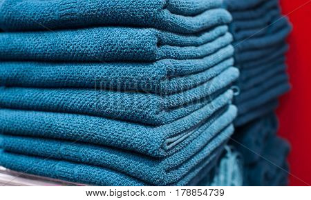 Blue towels on the shelf in the closet.