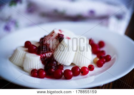 sweet dessert panna cotta with berries on a wooden table