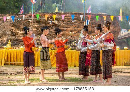 Thai girls and laos girls splashing water during festival Songkran festival