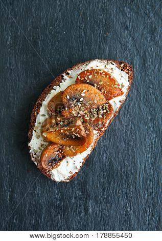 Rye Bread Bruschetta.  Mushrooms And Cream Cheese Sandwich Served On A Stone Board On Blue Backgroun