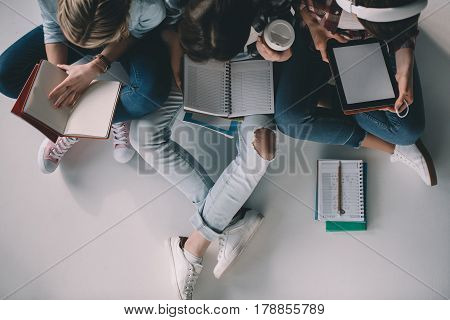 Overhead View Of Women Students Studying Together