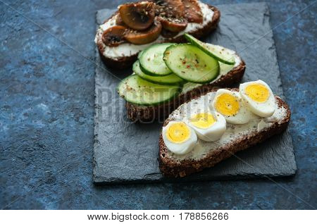 Mix Of Rye Bread Bruschettas With Various Filling. Mashrooms Quail Eggs Cucumber Sandwiches Served O