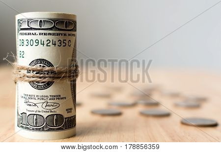 Roll money dollar banknote with coins on table American US currency bills Copy space