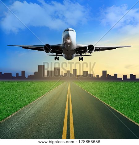 One Passenger Airplane Takes Off From A Runway. Beautiful Blue Cloudy Sky And Sunset Background. Gra