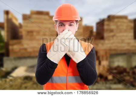 Male Architect Covering His Mouth With Hands