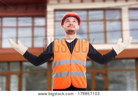 Self-confident Construction Worker Rising His Hands Up