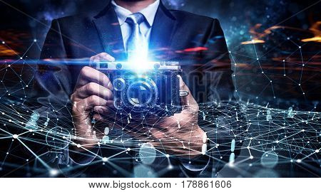 Businessman taking photo with vintage camera