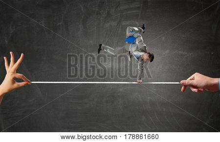 Young businessman breakdancer. Mixed media