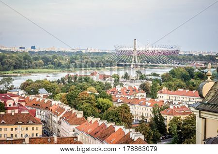 WARSAW, POLAND - SEPTEMBER 27: View of the Swietokrzyski Bridge, the National Stadium from the Old Town in Warsaw, Poland on September 27, 2016
