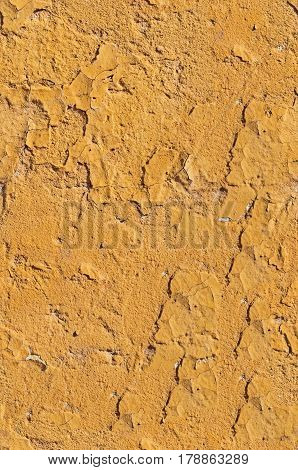 Photo (not a computer rendering) old grungy yellow background of natural cement or stone. Seamless texture pattern wall