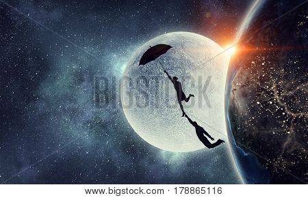 Woman flying on umbrella