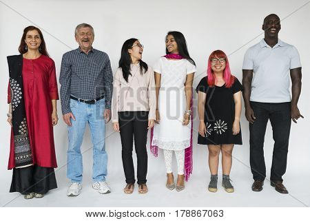 Cheerful Group of People Smiling and Standing in a row