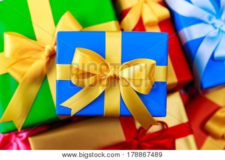 Gift boxes with bow. Colored presents wrapped with paper and ribbons. Christmas or birthday packages. Celebration design background.