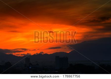 sunrise in sky beautiful colorful before dawn nature landscape with city silhouette
