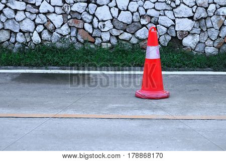 Traffic cone old white and orange stripes on the street with copy space