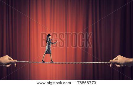 She is walking blindfolded