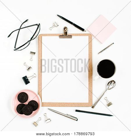 Pale pink home office workspace desk frame with clipboard coffee cookies glasses and office stuff on white background. Flat lay top view. Entrepreneur office concept.