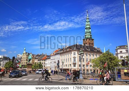 COPENHAGEN DENMARK - JUNE 15: Crossroad with Statue of Bishop Axel Absalon and St. Nicholas Church Hojbro Plads in 2012.