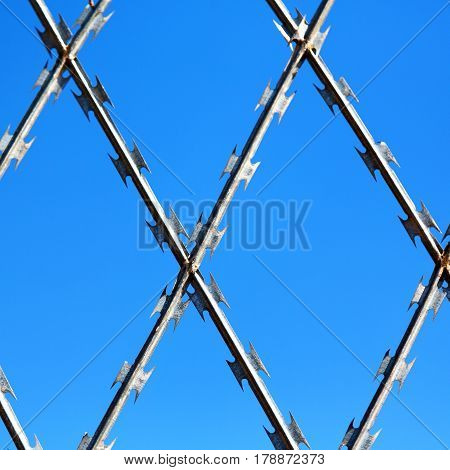 Abstract Razor Wire In The Clear Sky