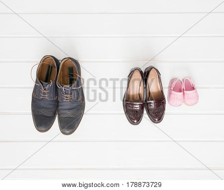 Males females and children shoes setup on white background