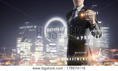 Businessman sketching his ideas