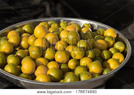 Fruit orange (Citrus Japonica Thunb) on Stainless steel tray.
