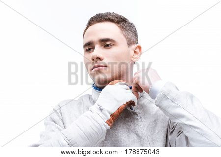 Young Man Professional Fencer Wearing Protective Costume On White