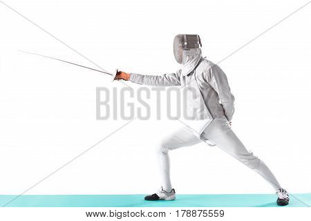 Side View Of Fencer In Uniform Trainign With Rapier In Hand On White