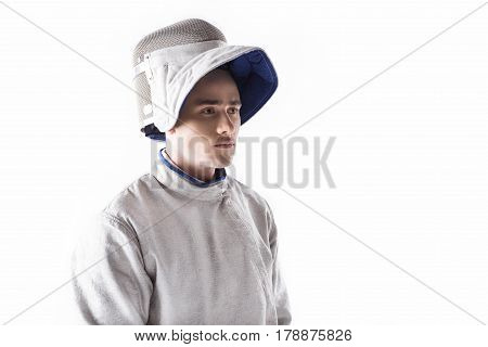 Portrait Of Serious Fencer In Mask And Uniform For Training On White