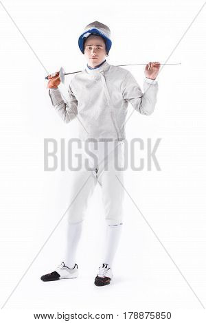 Serious Fencer In Uniform Holding Rapier For Training On White