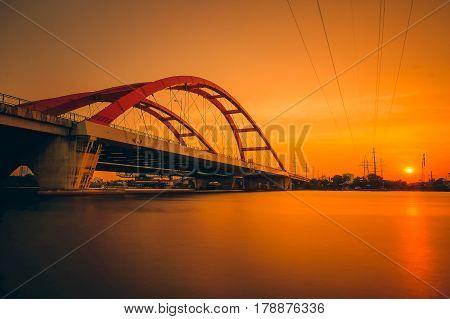 Beautiful yellow sunset on Binh Loi Bridge. Ho Chi Minh City, Vietnam