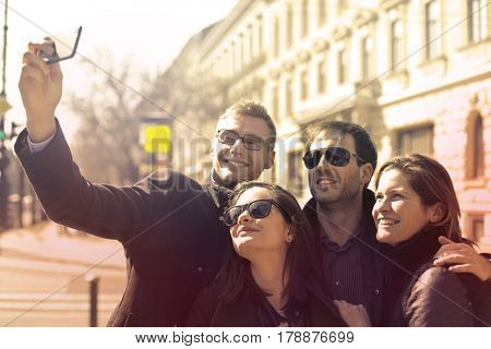 Group of friends taking a picture of themselves