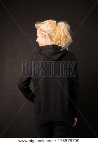Woman in black hoodie from the back
