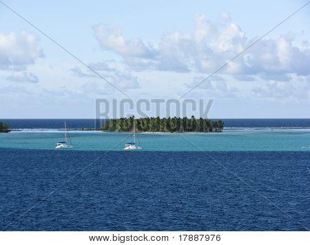 Two Sailboats in a calm Lagoon