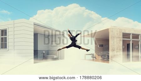 Jumping businesswoman in office. Mixed media