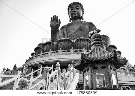 The enormous Tian Tan Buddha (Big Buddha) in black and white color at Po Lin monastery Hong Kong with copy space