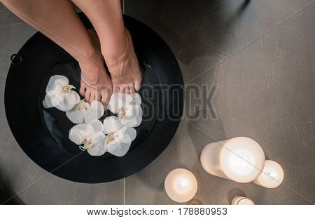 High angle close-up view of female feet during Asian therapeutic washing at luxury beauty center