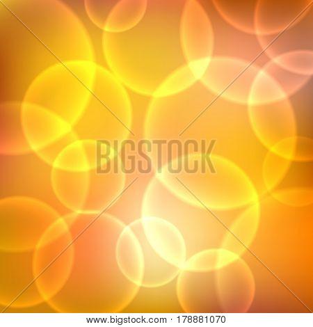 Shining orange background with light effects. Magic defocused glitter sparkles. Blurred soft backdrop. Vector illustration. EPS10